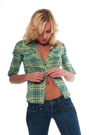 undressing girl: Pretty young blonde woman in a green plaid shirt and jeans