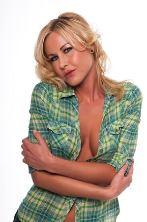 Pretty young blonde woman in a green plaid shirt and jeans photo