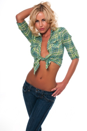 Pretty young blonde woman in a green plaid shirt and jeans Stock Photo - 12474000