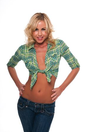 shirt unbuttoned: Pretty young blonde woman in a green plaid shirt and jeans