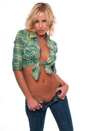 women in jeans: Pretty young blonde woman in a green plaid shirt and jeans