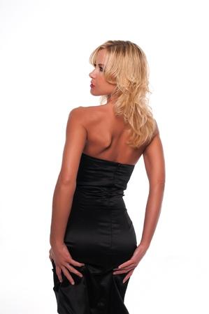 Pretty young blonde woman in a black sheath dress photo