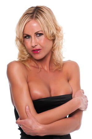 Pretty young blonde woman in a black sheath dress Stock Photo - 12473998