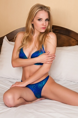 Pretty blonde woman dressed in blue lingerie photo