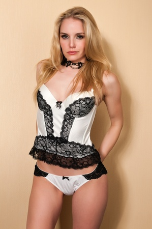 Pretty blonde woman in black and white lingerie photo