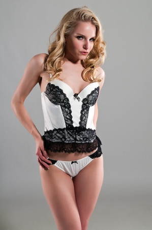 Pretty blonde woman in black and white lingerie