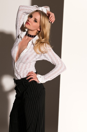 blouse sexy: Pretty blonde woman in black and white Stock Photo