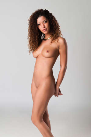 undressed young: Beautiful nude wavy haired multiracial woman