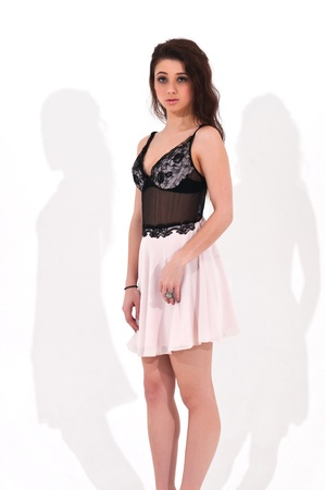 Pretty young brunette in a brown lace top and pink skirt