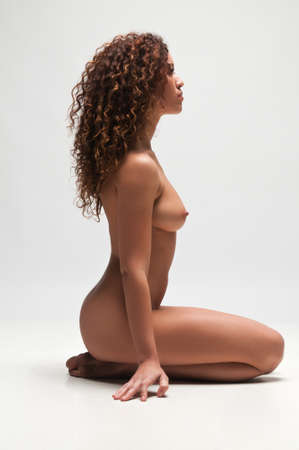 Beautiful nude wavy haired multiracial woman Stock Photo - 12858379
