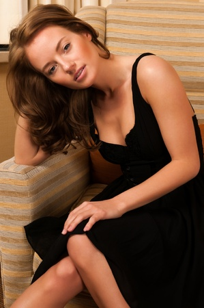 Pretty young brunette in a little black dress Stock Photo - 12858188