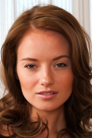 Closeup on the face of a beautiful young brunette Stock Photo - 12961198