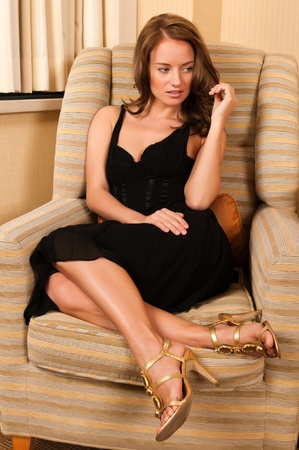 Pretty young brunette in a little black dress Stock Photo - 13027607