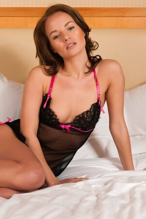 negligee: Pretty young brunette in a black negligee Stock Photo