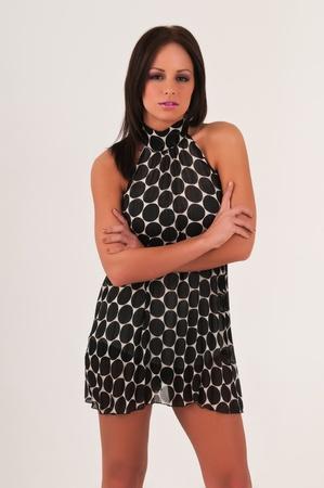 Pretty petite brunette in a vintage 60s dress