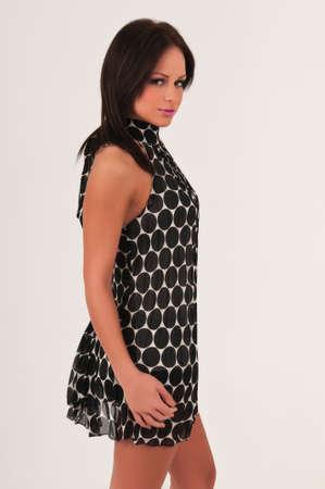 Pretty petite brunette in a vintage 60s dress Stock Photo - 13027541