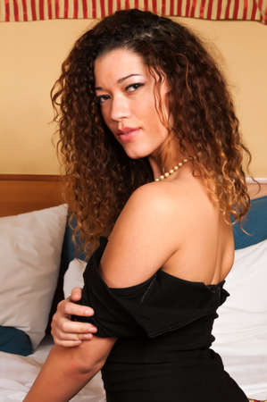 Beautiful multiracial woman in a little black dress photo
