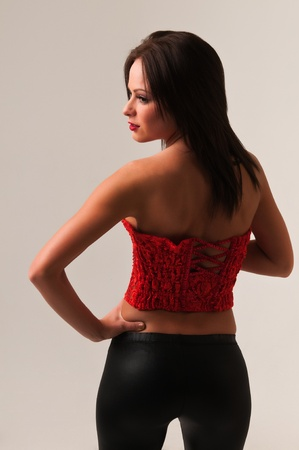 Pretty petite brunette in a red bustier