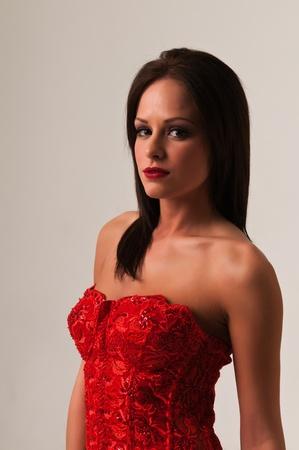 Pretty petite brunette in a red bustier