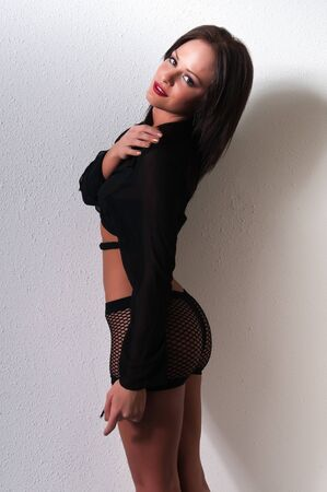 mesh: Pretty petite brunette in a black blouse and mesh shorts