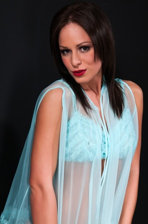 Pretty petite brunette in a turquoise bra and wrap Stock Photo