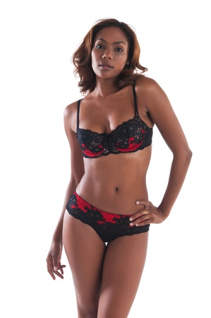 Beautiful young multiracial woman in red and black lingerie Stock Photo - 13027668