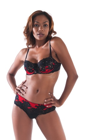 Beautiful young multiracial woman in red and black lingerie photo