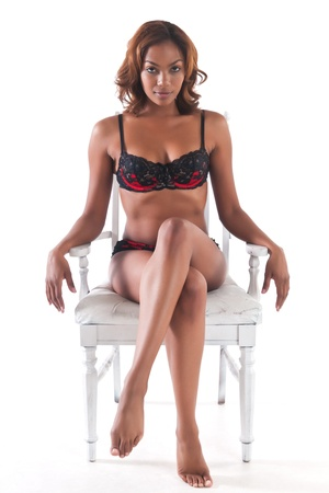 african sexy: Beautiful young multiracial woman in red and black lingerie