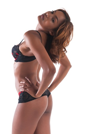 african american woman: Beautiful young multiracial woman in red and black lingerie