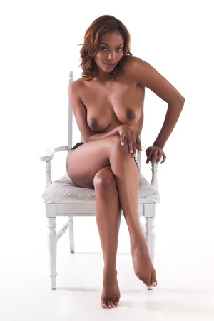 Beautiful young multiracial woman topless on white