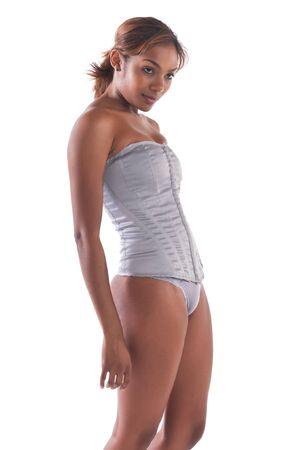 white panties: Beautiful young multiracial woman in a gray corset