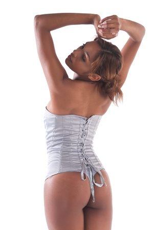 Beautiful young multiracial woman in a gray corset photo
