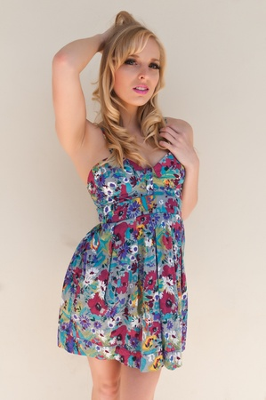 Blue eyed California blonde in a summer dress