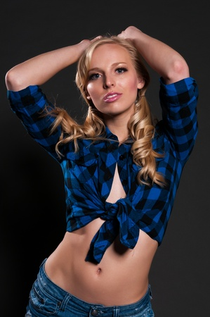 blue eyed: Blue eyed blonde in a plaid shirt and denim shorts