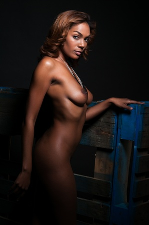 naked african: Beautiful young multiracial woman standing nude on black