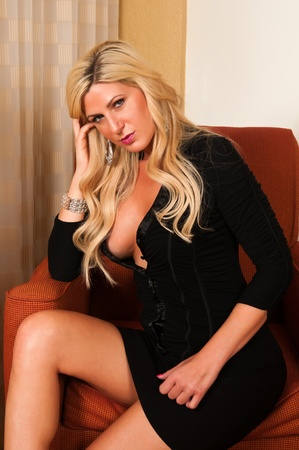 curvy: Beautiful mature blonde in a little black dress