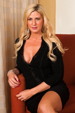 Beautiful mature blonde in a little black dress Stock Photo - 13162509