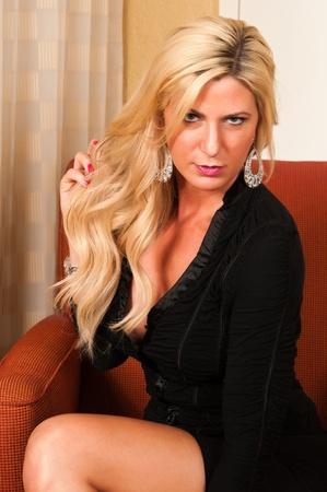 Beautiful mature blonde in a little black dress Stock Photo - 13162502