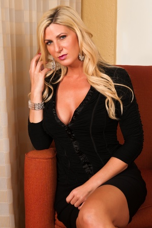 Beautiful mature blonde in a little black dress Stock Photo - 13162503