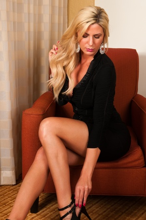 voluptuous: Beautiful mature blonde in a little black dress