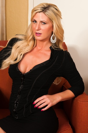 Beautiful mature blonde in a little black dress Stock Photo - 13162484