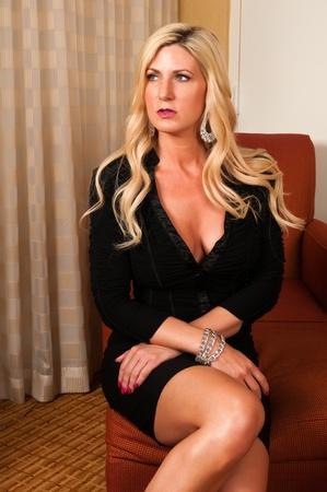 Beautiful mature blonde in a little black dress Stock Photo - 13162512