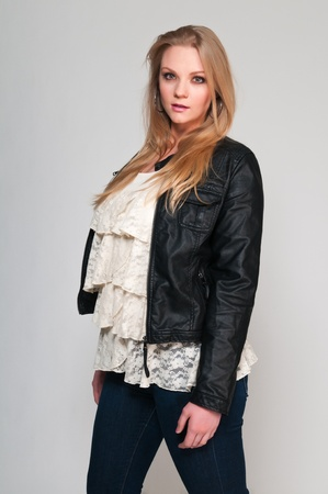 Pretty young plus size blonde in a frilly blouse photo