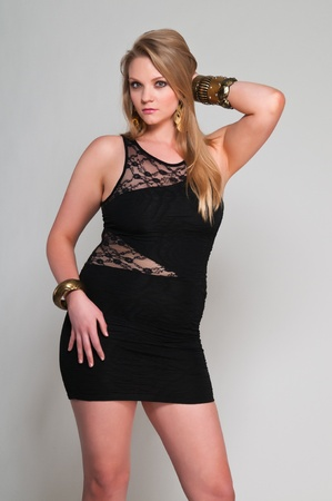 Pretty young plus size blonde in a black dress