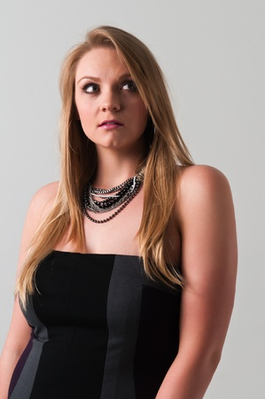 Pretty young plus size blonde in a black dress Stock Photo - 13162560