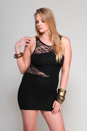 Pretty young plus size blonde in a black dress Stock Photo - 13162547