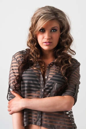 Pretty young woman with wavy brown hair photo