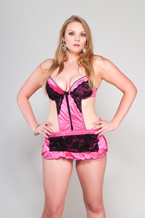 Pretty young plus size blonde in pink lingerie photo