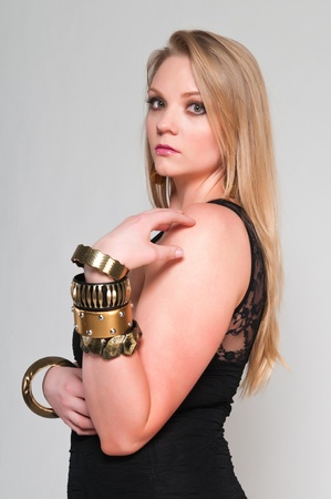 Pretty young plus size blonde in a black dress photo