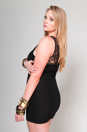 voluptuous: Pretty young plus size blonde in a black dress
